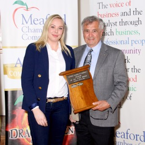 Rod MacAlpine accepting the Tourism Award for the Meaford International Film Festival- Sponsored by Third Line Homes, Presented by Paige Osbourn